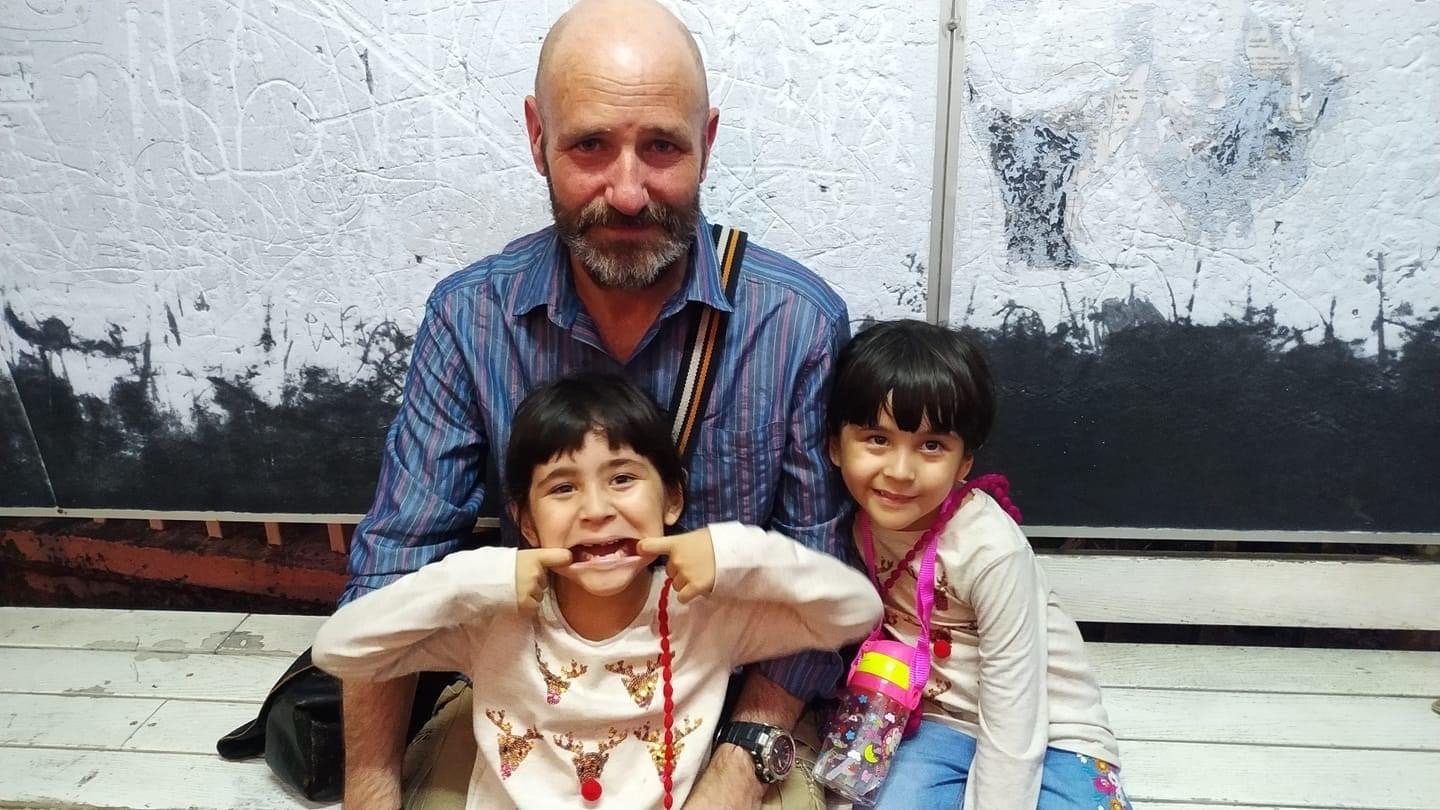 Photo of Paul Bennett, after which the Volunteer Manager of the Year Award is named, with his twin girls Jessica and Jasmine